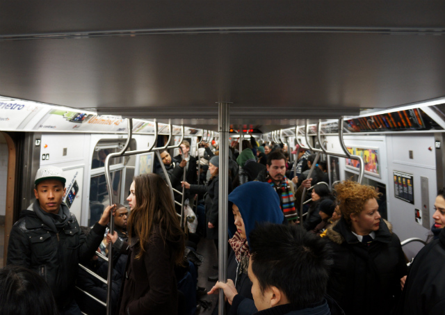 Crowds on an uptown F train on a Sunday afternoon. It could be much worse. Image by Pacific Coast Highway.