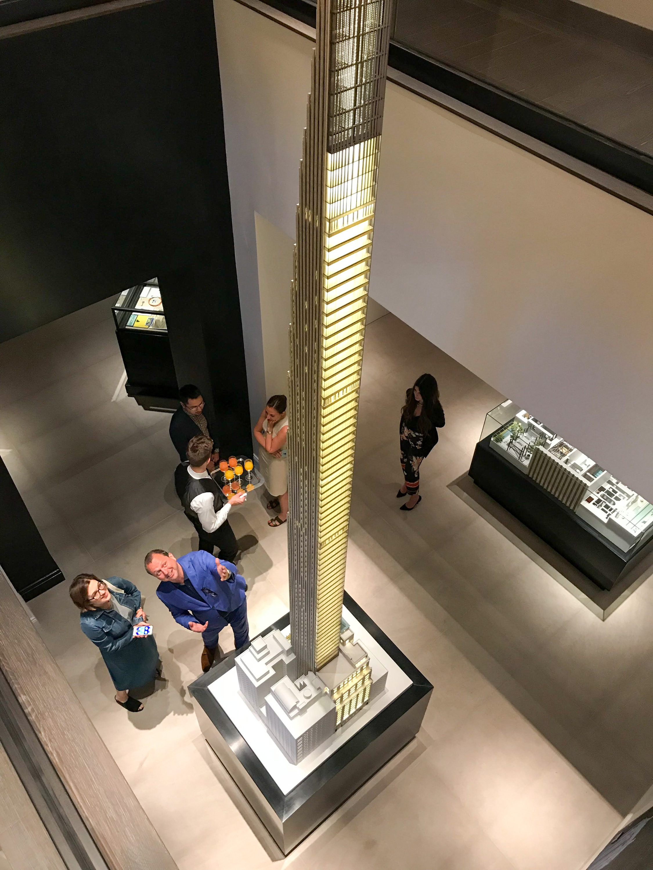 Scale Model of 111 West 57th Street with Gregg Pasquarelli at the base, image from the Sales Gallery