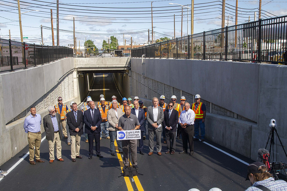 Long Island Rail Road President Phillip Eng (front) addresses members of the press at the WIllis Avenue LIRR station - Metropolitan Transportation Authority of the State of New York